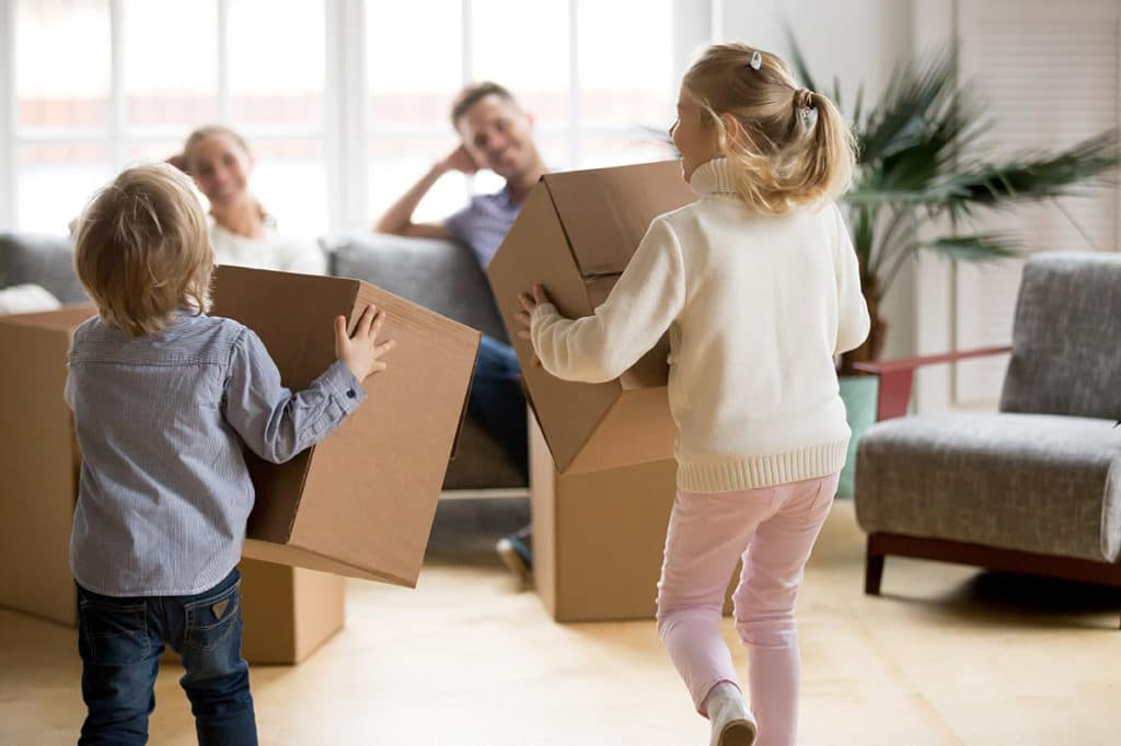 Kids playing with cardboard boxes