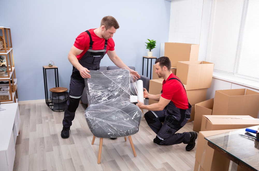 Picture of two men packing things