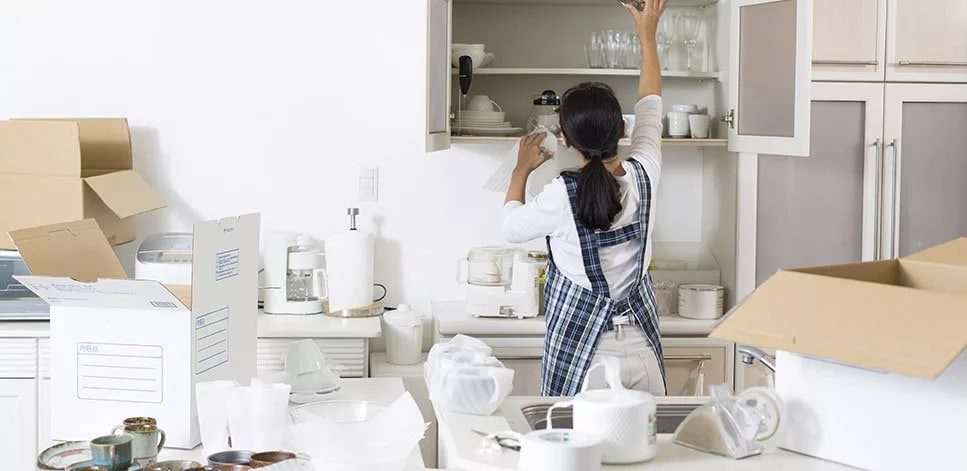 Picture of a woman unpacking kitchen things