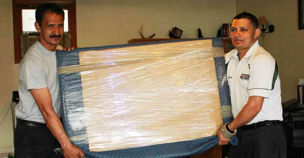 Picture of two men holding cardboard box